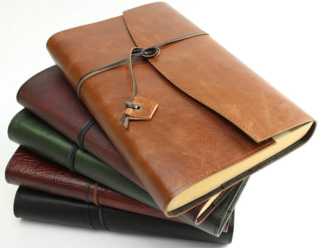 Leather Book Wraps.  Handcrafted in Australia to protect your books in style.  Two inside pockets for storing pens, papers, notes etc. Slide pocket for the back cover of the book to slide underneath to hold book securely. Close with the kangaroo leather wrapping strap.